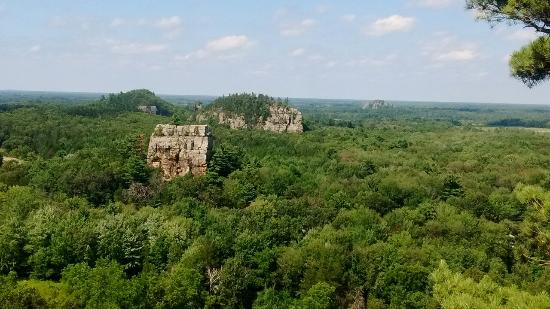 Camp Douglas, WI : View from top of Mill Bluff shows other nearby bluffs and spring feed swimming area.