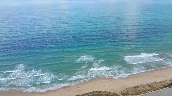 Island Suites Hotel: view from balcony of beach and Mediterranean Sea