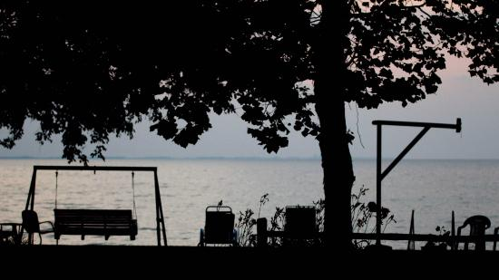 The Five Bells Inn: The swing and chairs and the lake /sunset facing view