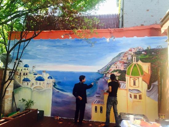 Crabtrees Restaurant: Talented artist Jaleel Akaloo finalizing his mural