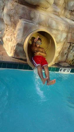 Holiday Inn & Suites North Beach : My son coming down the water slide.