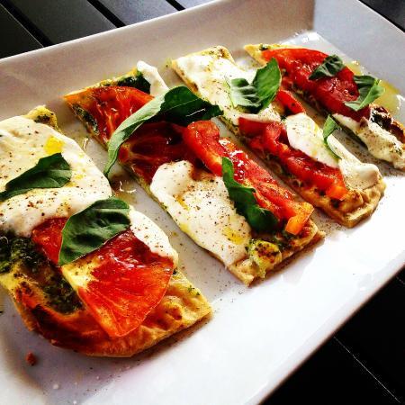 """Solstice Kitchen : Flatbread """"Margherita""""  w/herb pesto, today's tomatoes, buffalo mozzarella, EVOO & basil."""