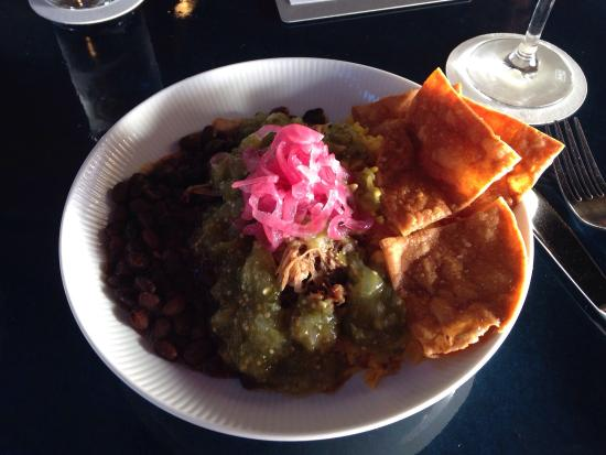 Joe's Nuevo Latino: Some of the delicious happy hour offerings. Yum! The Carnita's bowl and Pisco Sour.
