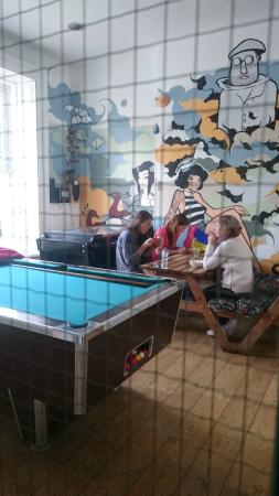 Global Village: Pool table and dining room