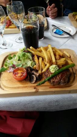Ravintola Wanha Mylly : Steak on a plank by restaurant Wanha Mylly