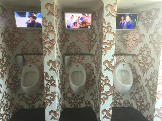 Litore Resort Hotel & Spa: The amazing tiled urinals with TV!