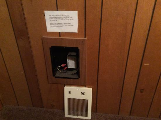 The Red Rooster Lodge: Open electrical box on bedroom wall