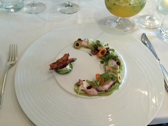 Green olive and herb grilled octopus, Ottawa black garlic, pickled carrots, avocado cream