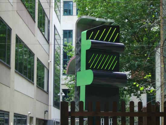 the home office building garden sculpture revolves clockwise showing green neon building home office