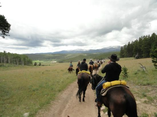 Paradise Guest Ranch: View of the ranch in the distance while trail riding
