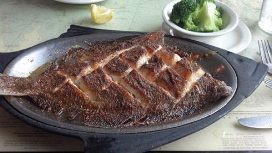 Baked Flounder served with 2 sides at the Mariner Restaurant.