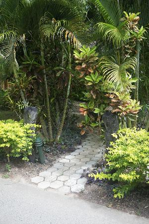 Namale Resort & Spa: A path to one of the many bures on the property. Pavers are etched with the names of every guest