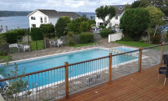 Merlewood Hotel: Pool from decking with sea in background