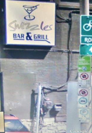 ‪Swizzles Bar and Grill‬