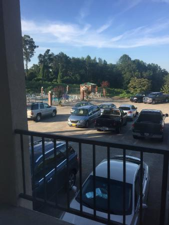 Quality Inn Dahlonega: The parking lot with pool in corner.