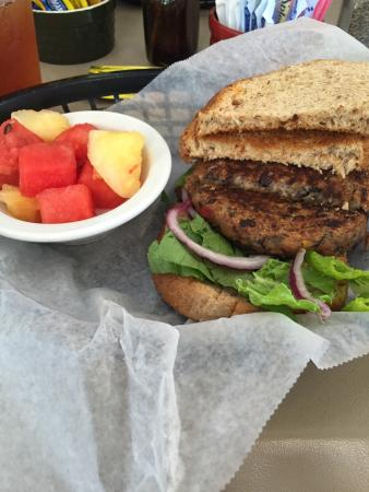 Black bean burger on wheat with fruit of the day.