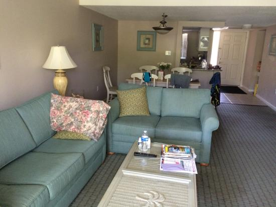 Seawatch at the Island Club: Beach themed living room and dining area #7205