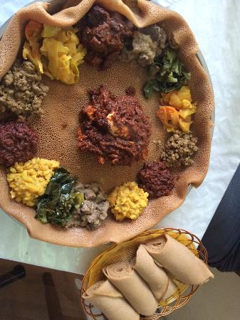 Meat veggie platter with injeras picture of abyssinia for Abyssinia ethiopian cuisine