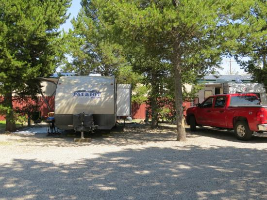 Rustic Wagon RV Campground & Cabins: Our trailer in site #19 on the left; the neighbor's truck in site #20 on the right.  Cozy.
