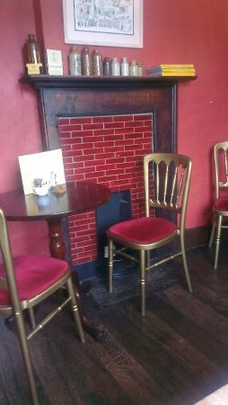 Castle Kitchen: Cute little fireplace upstairs