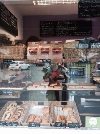 Lucia's : The front of the shop and the sausage rolls, tarts and flapjacks in the window.