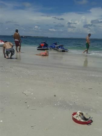 Sunshine Jet Ski Rental: Relaxing on the beach.