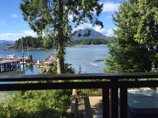 Tofino Inlet Cottages: View from the upper deck of the harbor and islands across.  Hot tub on lower deck in bottom righ