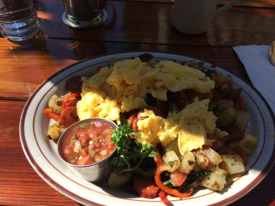 Fire Sign Cafe: Excellent dish of sausage bell peppers onions roasted potatoes and scrambled eggs on top.