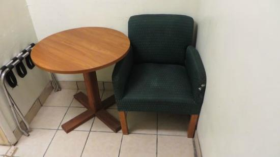 Budget Inn & Suites Colby: Badly worn and stained chair with paint splotches.