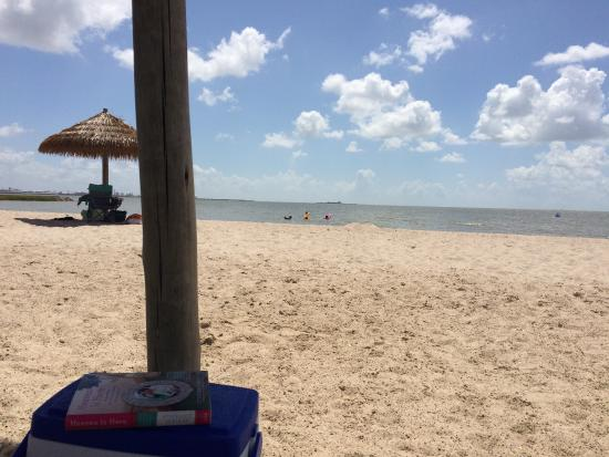 Lighthouse Beach: View from under an umbrella. View from the playscape seeking shade from the sun!