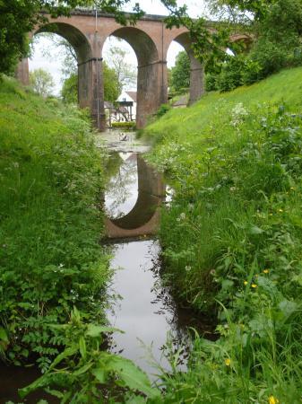 Eardington, UK: View of Daniel's Mill through Severn Valley Railway viaduct