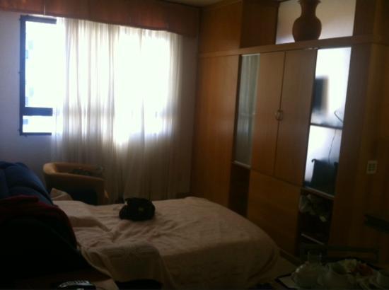 Differential Flat: Sala com sofa cama