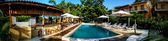 Hotel Villa Romana: Panorama of the main pool, including poolside bar and villas