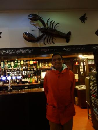 The Lobster Pot: Me by the bar and giant lobster