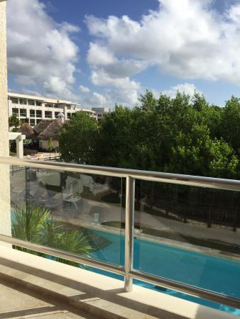 Paradisus Cancun: Some photos of a 1 bed suite seating area and balcony. Swim up pools look great and maintenance