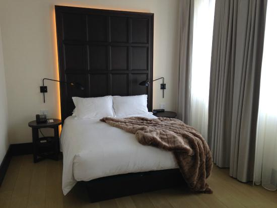 Don't worry, that headboard is not a portal to Hell.  The bed is actually pure Heaven!