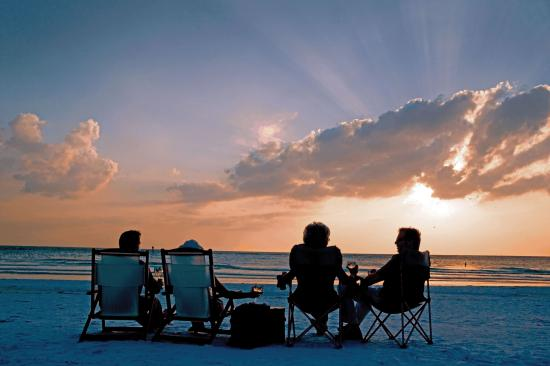 Siesta Key, FL: Sit back, relax and watch the sun set into the Gulf.
