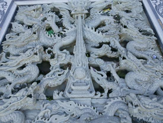 Stone carving near the entrance picture of quang minh