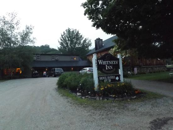 Whitney's Inn: entrance to Inn and some front parking,