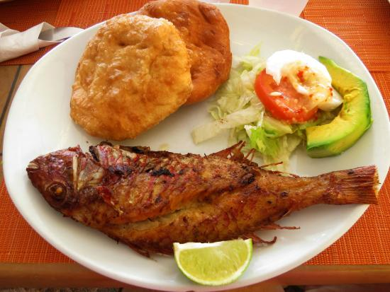 Enoch's Place: Fried whole fish with johnycakes, a traditional West Indian breakfast.
