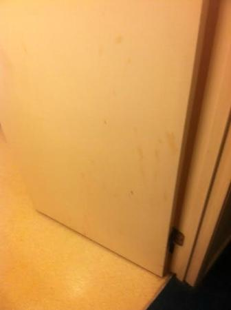 Cassandra Hotel: stained door....blood or grease, we will never know.