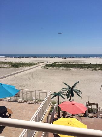 Madrid Oceanfront Condominiums: View from the 3rd. floor room overlooking 2nd floor deck and beach.