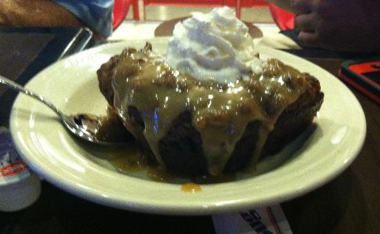 Dookey Chase's: Bread pudding served warm with sauce and whipped cream