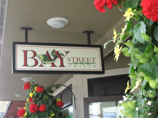Bay Street Grill sign with flowers in hanging baskets