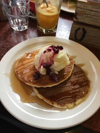 Vons Restaurant & Bar: Pancake Stack with Berries (Citrus juice in the background!)