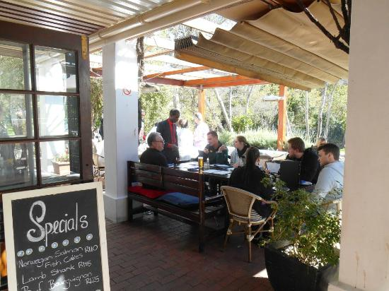 Pastis: Diners under shady awnings on the patio