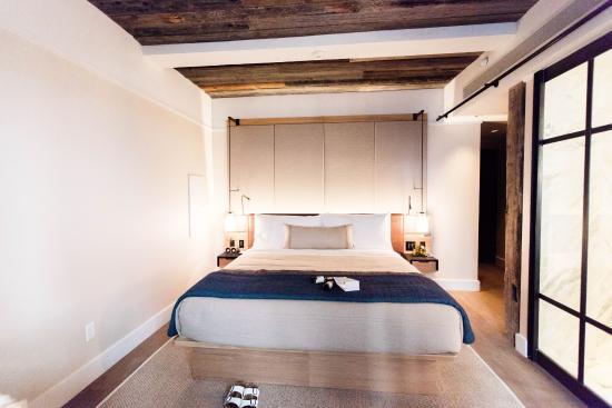 1 hotel central parks hotel room view of king bed on wooden bed frame - Hotel Bed Frames