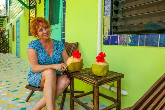 Casa Placencia Belize: Garden Room #4 guest enjoys her fresh coconut from our trees