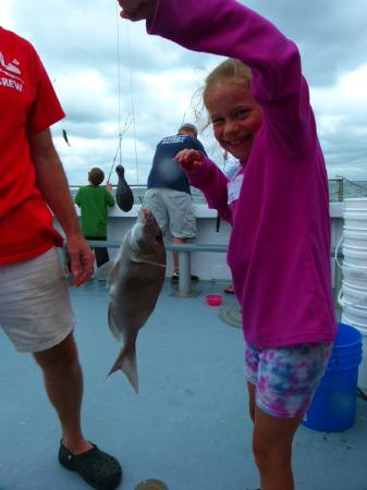 Cap'n Kids Fishing Adventures: First catch of the day  A scup.
