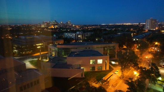 night view of the university and downtown in distance. Black Bedroom Furniture Sets. Home Design Ideas